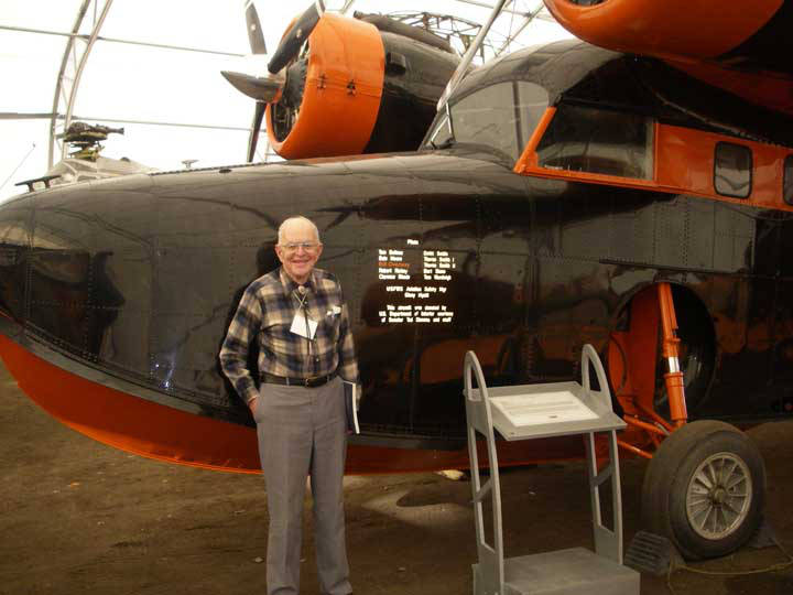 Ted Merrell with Grumman Goose N778 at the Alaska Aviation Museum.