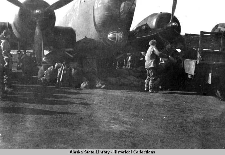 Military personnel unload Douglas B18A bomber in spring of 1943.